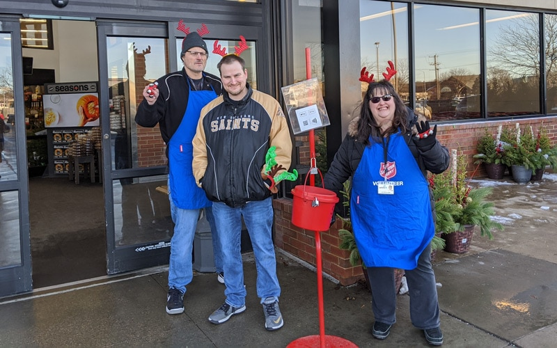 Cars For Sale employees bell ringing for the Salvation Army
