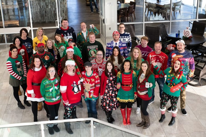 Group of ugly sweater participants